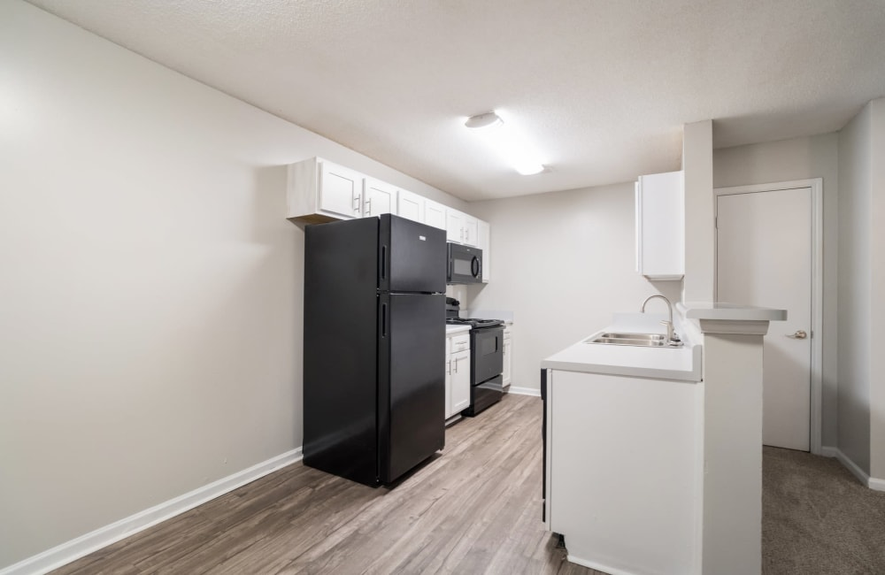 Beautiful spacious kitchen with black appliances at The Pointe at Ridge Cove in Jackson, Tennessee