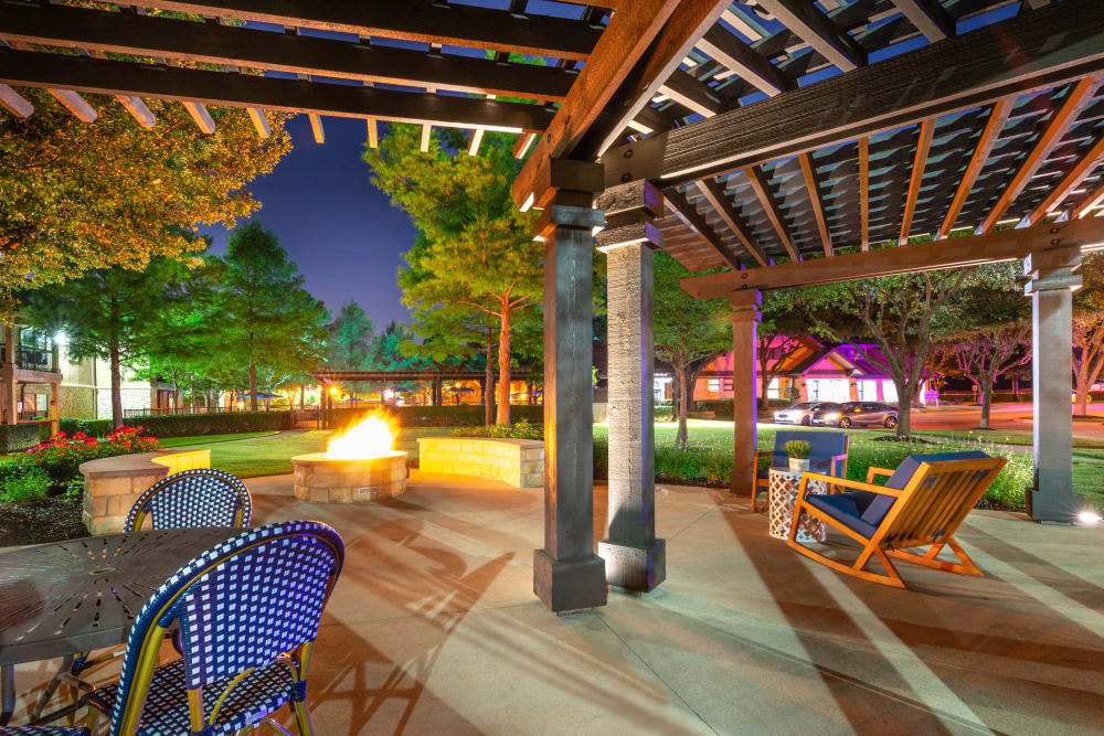 Dusk at the beautifully designed fire pit area at Olympus Town Center in Keller, Texas