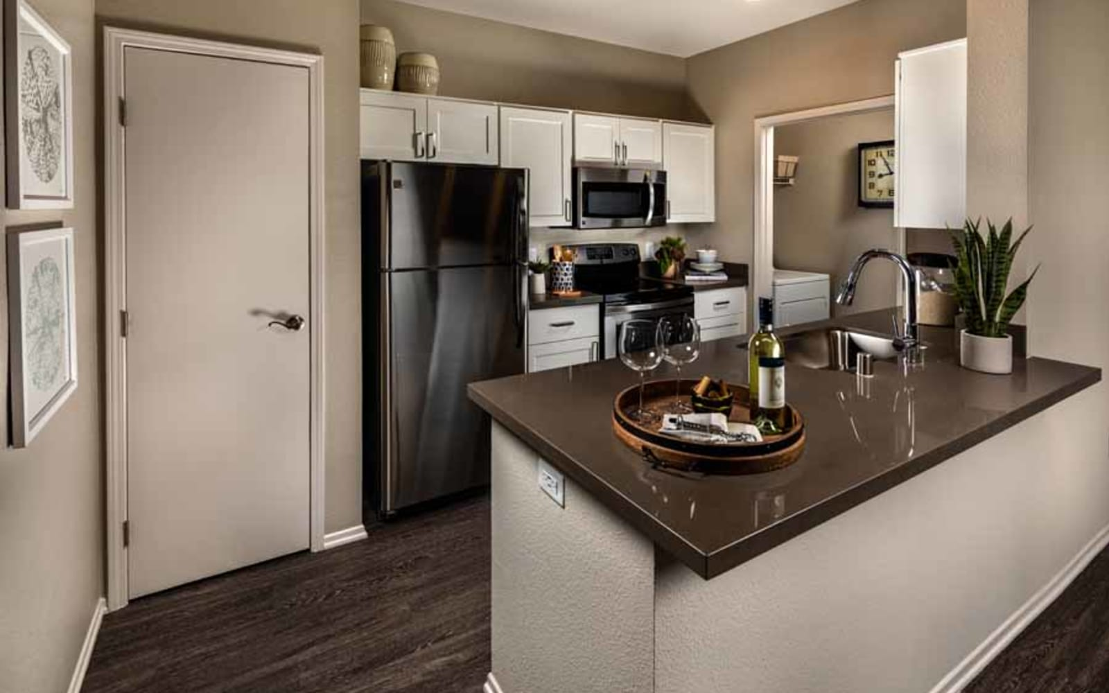 Stainless steel appliances in an apartment kitchen at Castlerock at Sycamore Highlands in Riverside, California