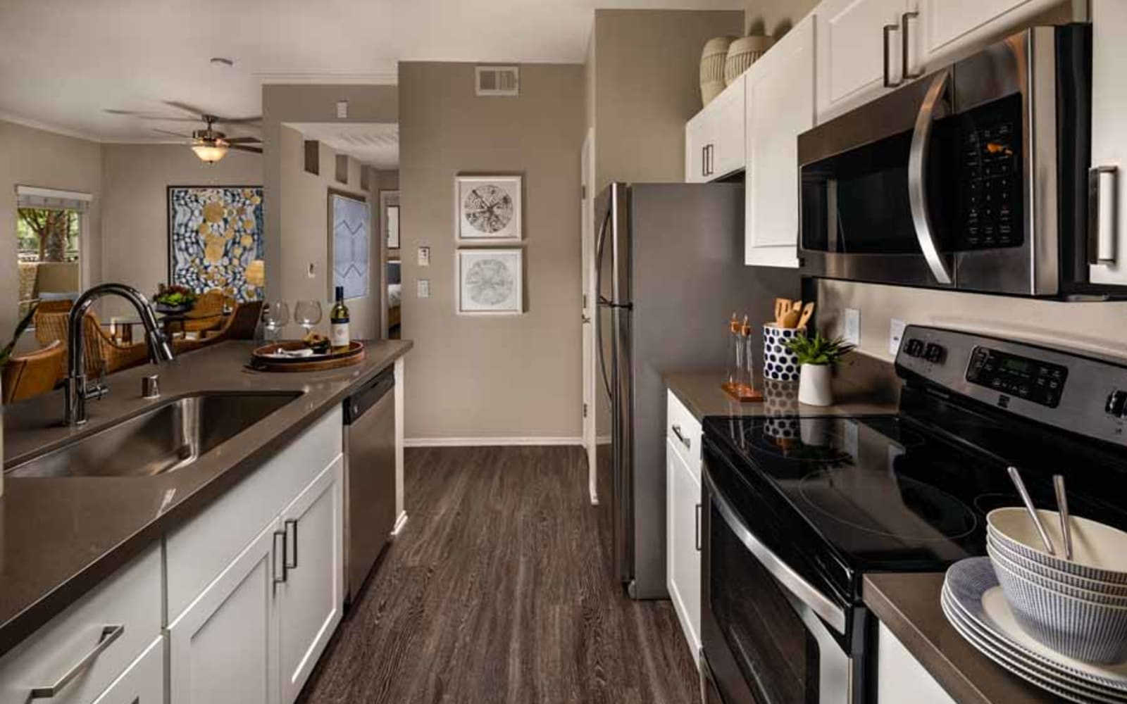 An apartment kitchen with plenty of counter space at Castlerock at Sycamore Highlands in Riverside, California