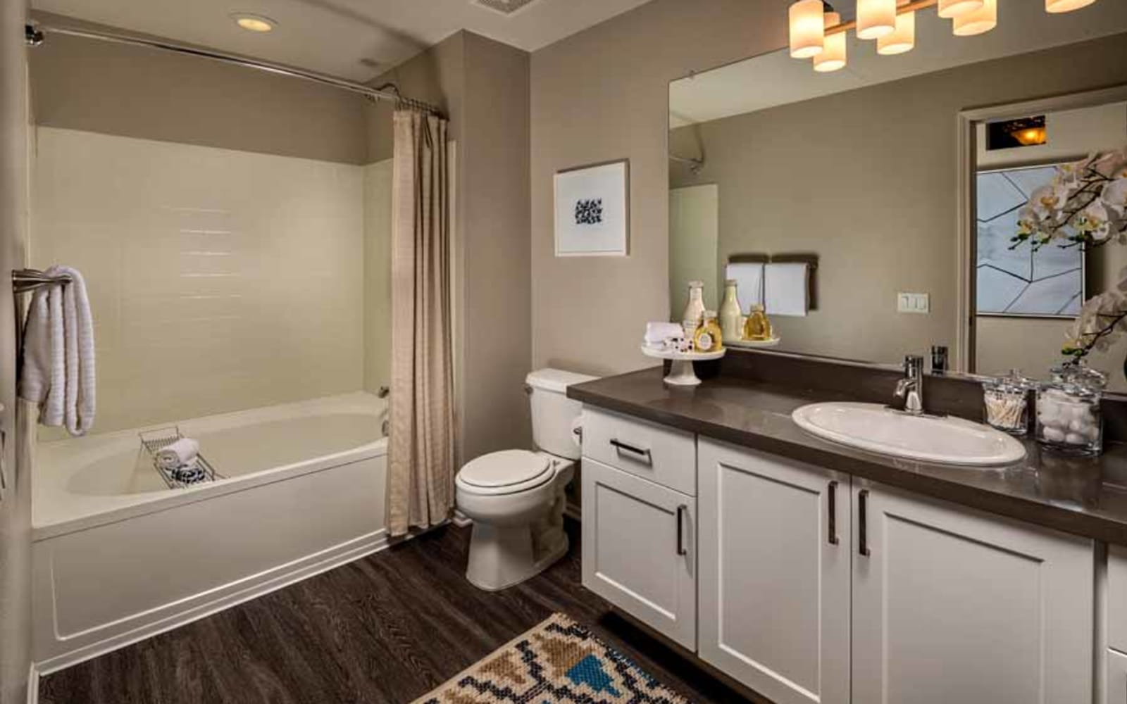 Wood flooring in an apartment bathroom at Castlerock at Sycamore Highlands in Riverside, California