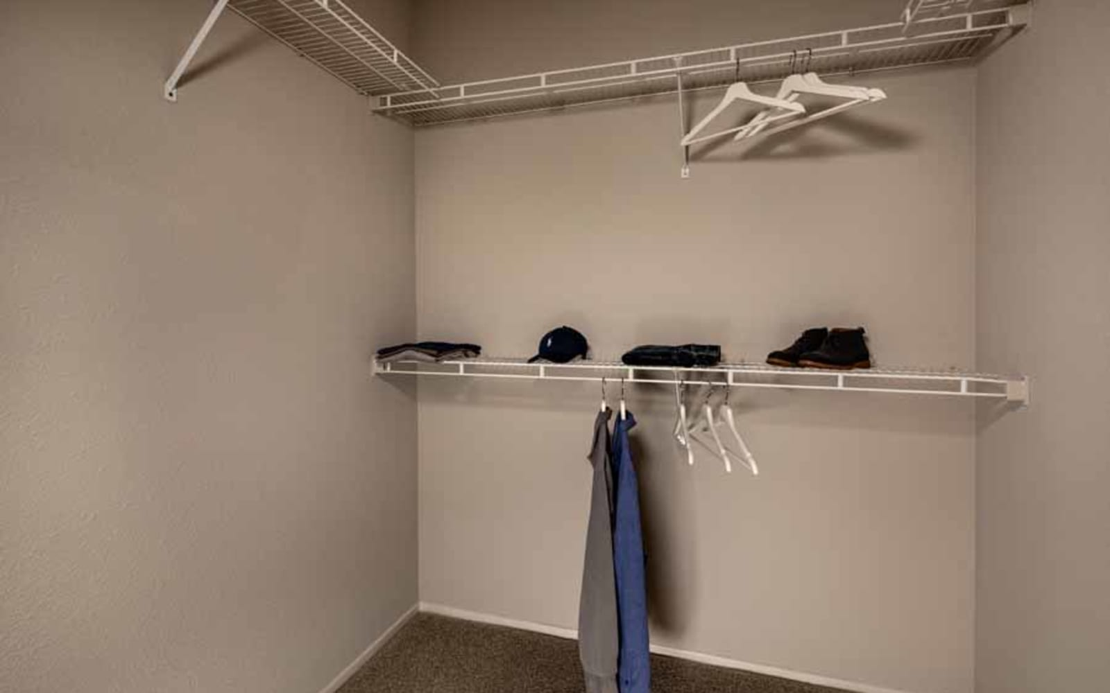 A walk-in closet at Castlerock at Sycamore Highlands in Riverside, California