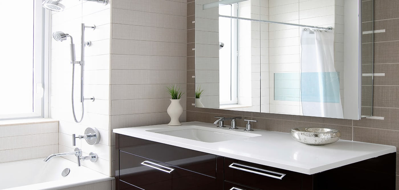Master bathroom with a large mirror at The Larstrand in New York, New York