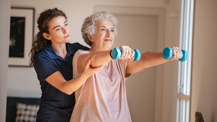 Senior working out with therapist