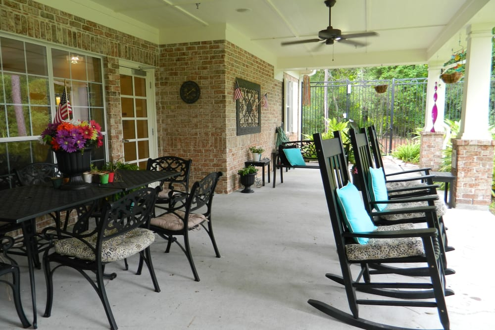 Covered outdoor seating at Autumn Grove Cottage at Humble in Humble, Texas