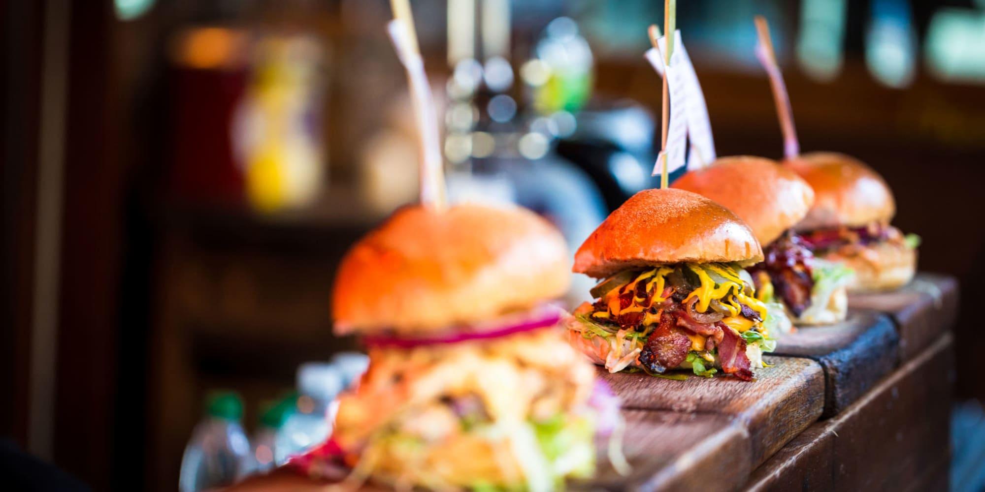 Tasty cheeseburgers on the bar at a locals' favorite restaurant near Mediterranean Village in West Hollywood, California