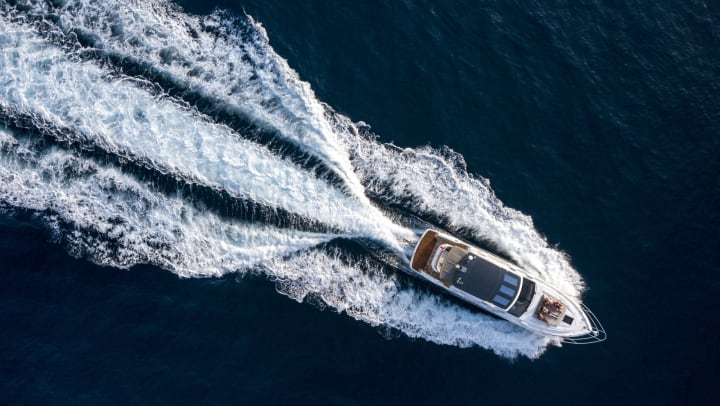 An aerial shot of a motor boat on a sunny day.