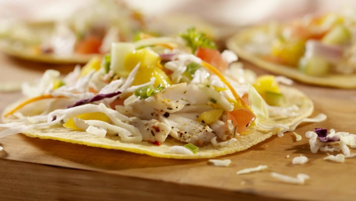 Closeup of grilled fish tacos with pineapple slaw