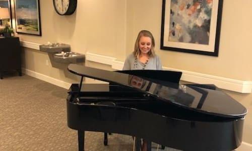 Woman play the piano at Salem, Oregon