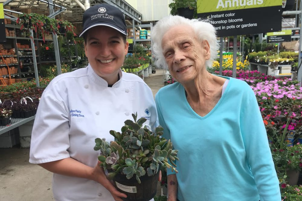 A resident and caretaker from Westport Place Health Campus in Louisville, Kentucky shopping for plants