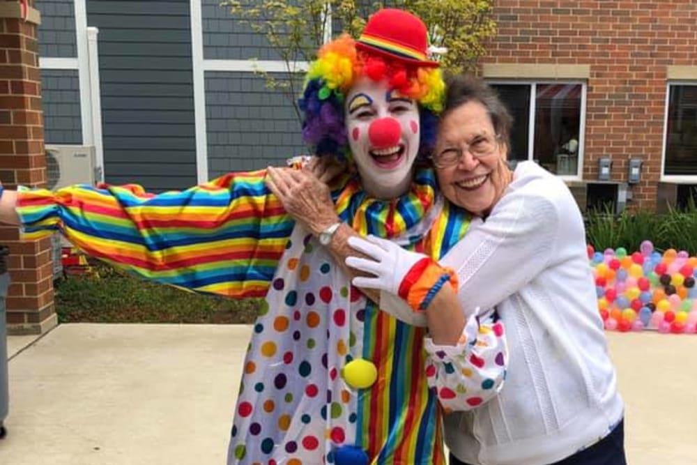 senior resident hugging a clown