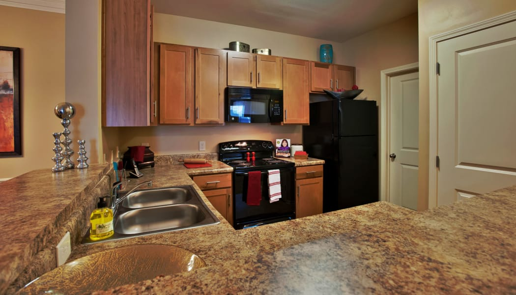 Modern kitchen with granite countertops in model home at Richland Falls in Murfreesboro, Tennessee