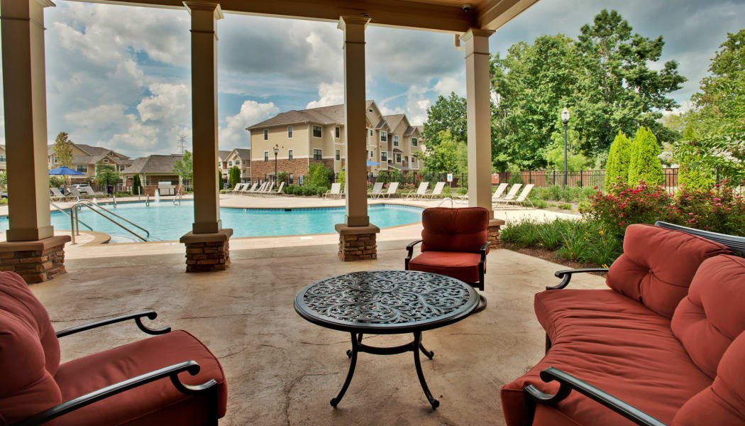 Comfortable and shaded seating area near the pool at Richland Falls in Murfreesboro, Tennessee
