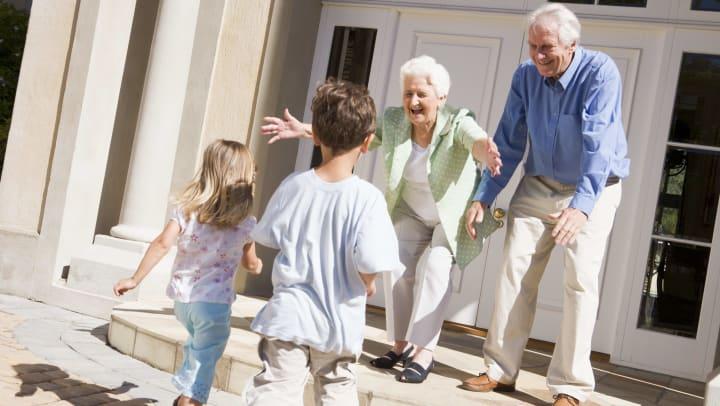 Grandparents greeting grandchildren