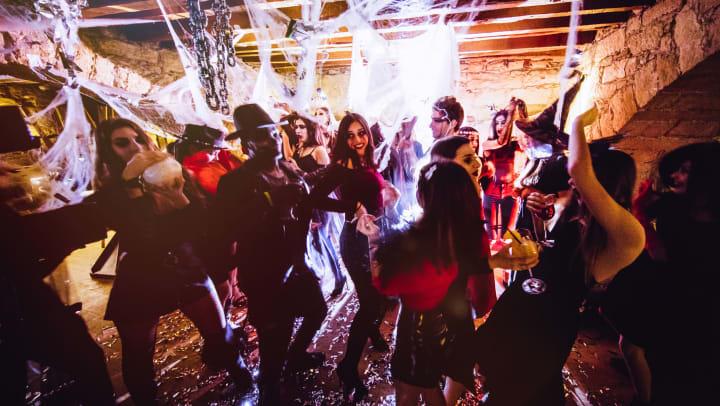 People dancing in costumes at a Halloween party near Vistara at San Tan Village