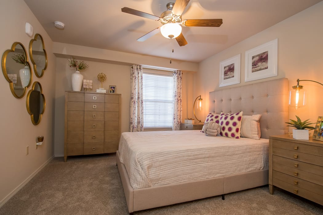 Well-lit bedroom at Portico at Friars Creek Apartments in Temple, Texas