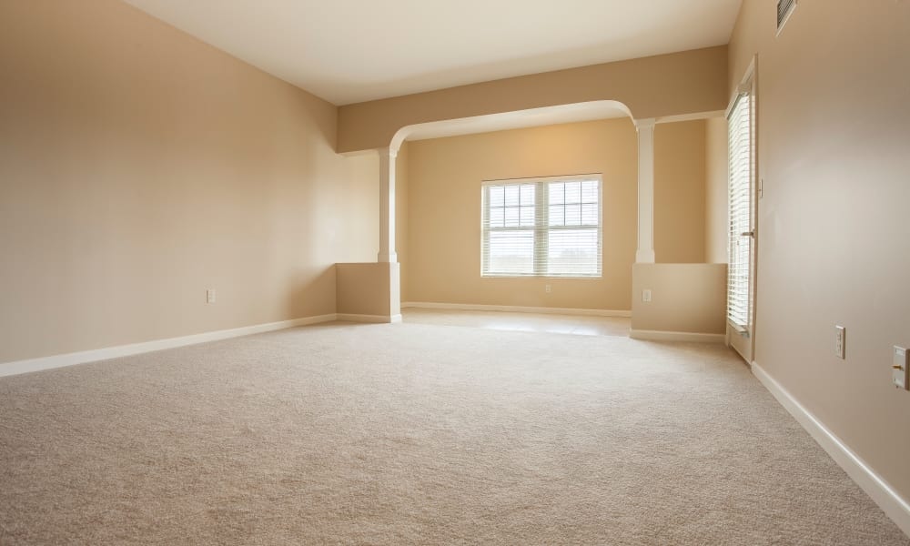 An empty apartment entrance and living room at Keystone Place at  Buzzards Bay in Buzzards Bay, Massachusetts