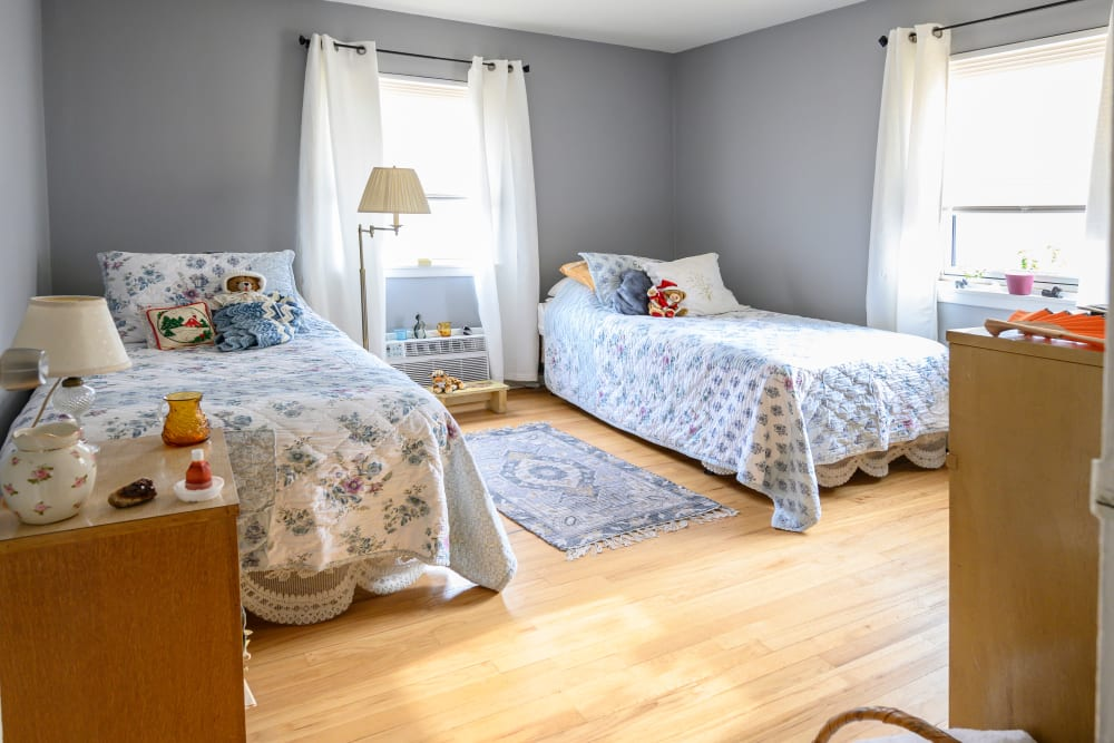 Modeled bedroom with two beds at Lafayette Park Apartments in Hawthorne, New Jersey