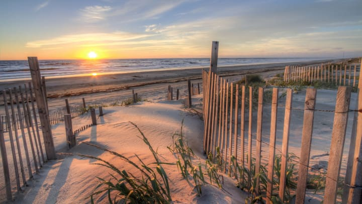 Sunrise over the sand dunes around Corolla Beach in North Carolina