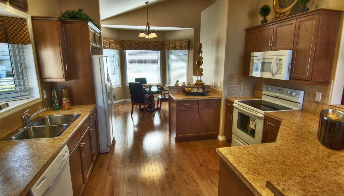 A cottage kitchen and dining room at Touchmark at Wedgewood in Edmonton, Alberta