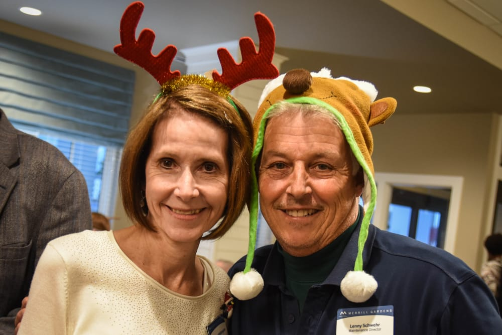 General Manager at Merrill Gardens at Carolina Park with team member at the community Christmas party