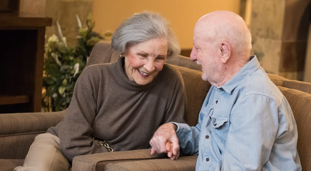 Resident couple relaxing in comfortable lounge area at The Springs at Tanasbourne in Hillsboro, Oregon