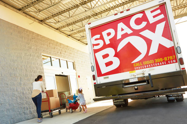 A family moving using the free moving truck at Spacebox Storage Nashville in Nashville, Tennessee.