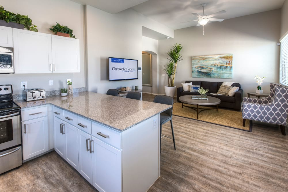 Beautiful open-concept floor plan with granite countertops and stainless-steel appliances in a model home at Christopher Todd Communities On Happy Valley in Peoria, Arizona