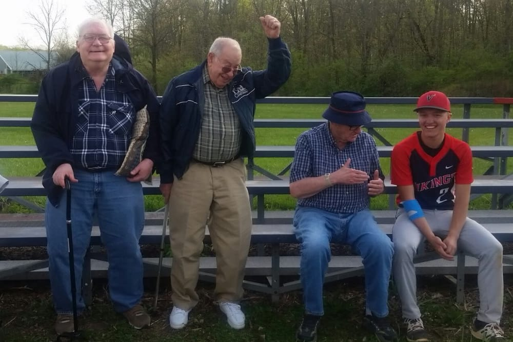 A group of residents from Senior Living at Forest Ridge in New Castle, Indiana at a little league baseball game