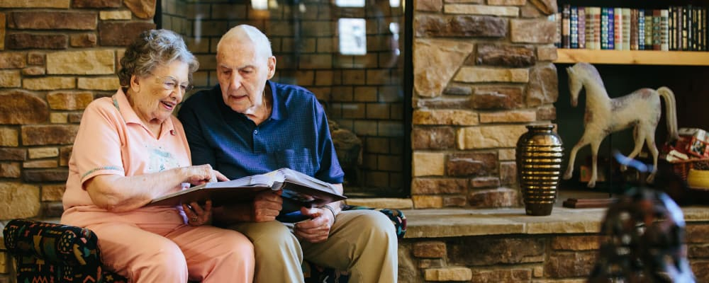 Residents reading together in the library at The Springs at Missoula in Missoula, Montana