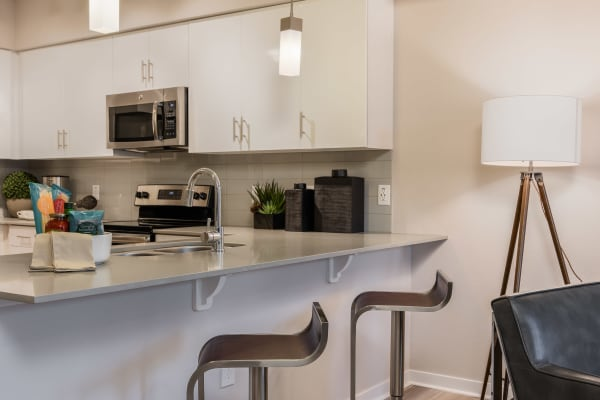 Kitchen with a spacious breakfast bar at Jefferson Chandler in Chandler, Arizona