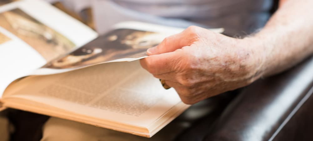 Resident reading a book at The Springs at Tanasbourne in Hillsboro, Oregon