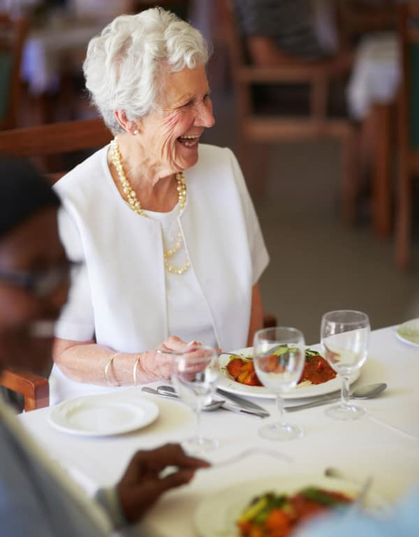 Resident enjoying dinner at The Phoenix at Lake Joy in Warner Robins, Georgia