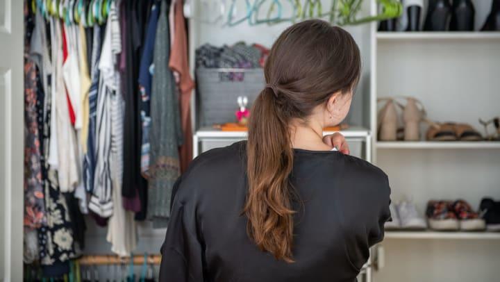 Woman looking in her closet at Olympus Corsair in San Diego, California