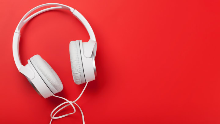 White headphones on a red table at Olympus Fenwick