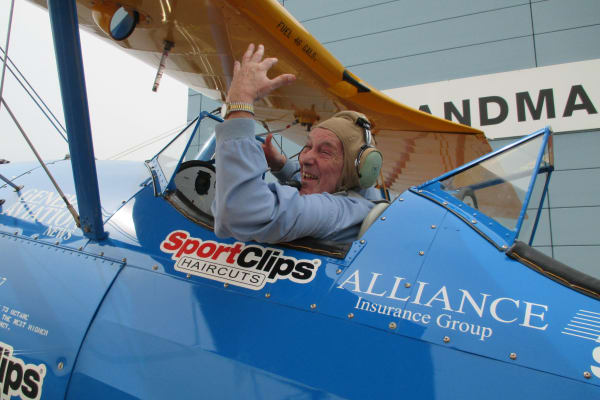 A resident from Meadowlark Estates Gracious Retirement Living in Lawrence, Kansas in a plane