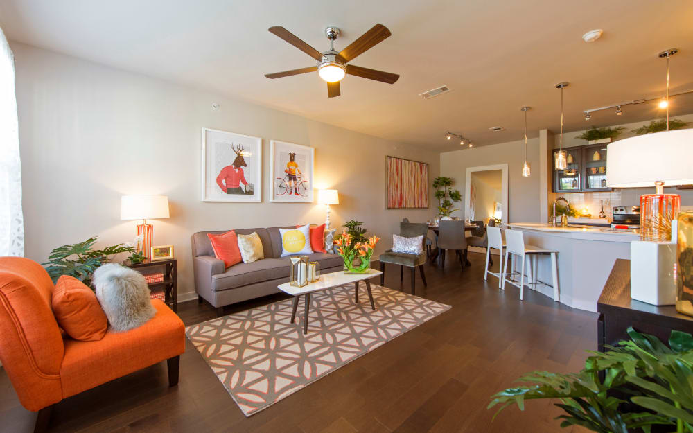 Spacious living room with wood-style flooring at Elite 99 West in Katy, Texas