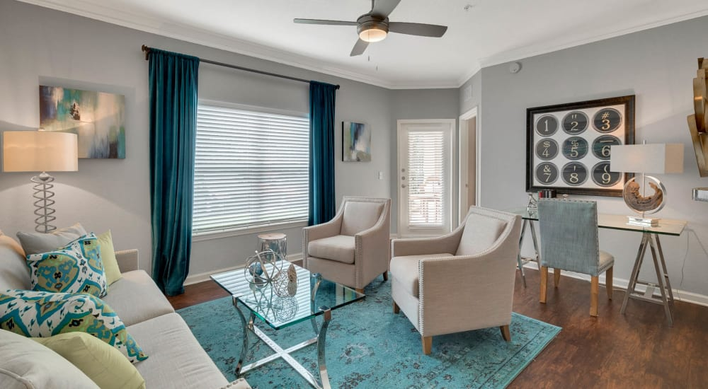 Large living room with a ceiling fan Palms at World Gateway in Orlando, Florida