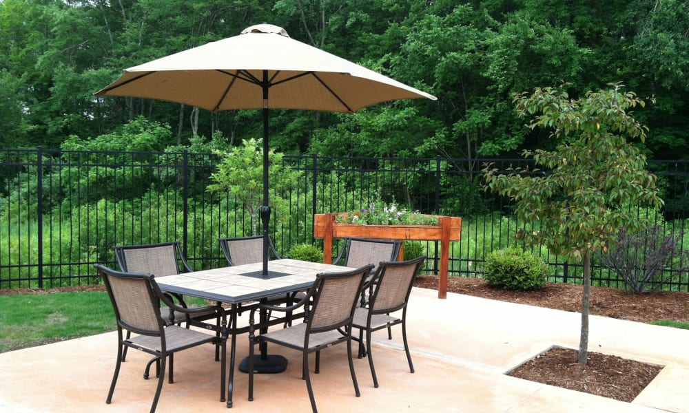 Covered patio seating at Keystone Commons in Ludlow, Massachusetts