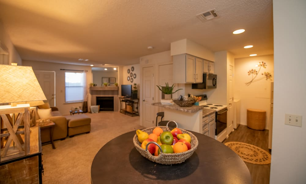 Living room, dining room and kitchen at Polo Run Apartments in Tulsa, Oklahoma