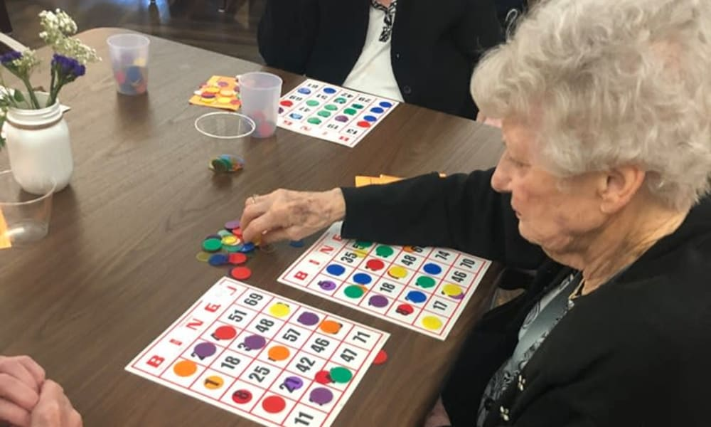 Residents playing bingo at The Legacy at Hawthorne Park in Greenville, South Carolina