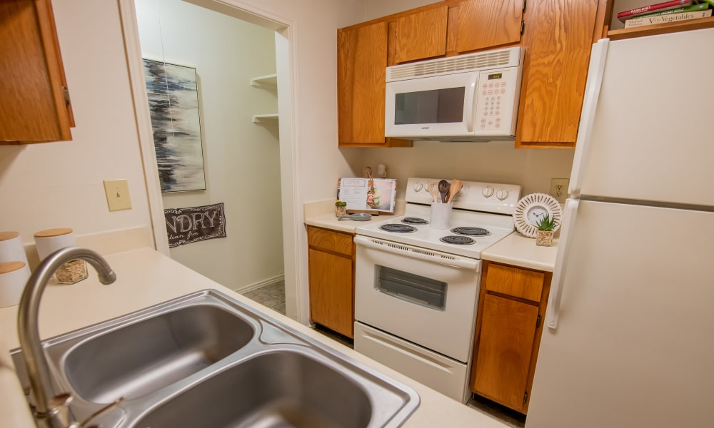 Kitchen with white appliances at Newport Apartments in Amarillo, Texas