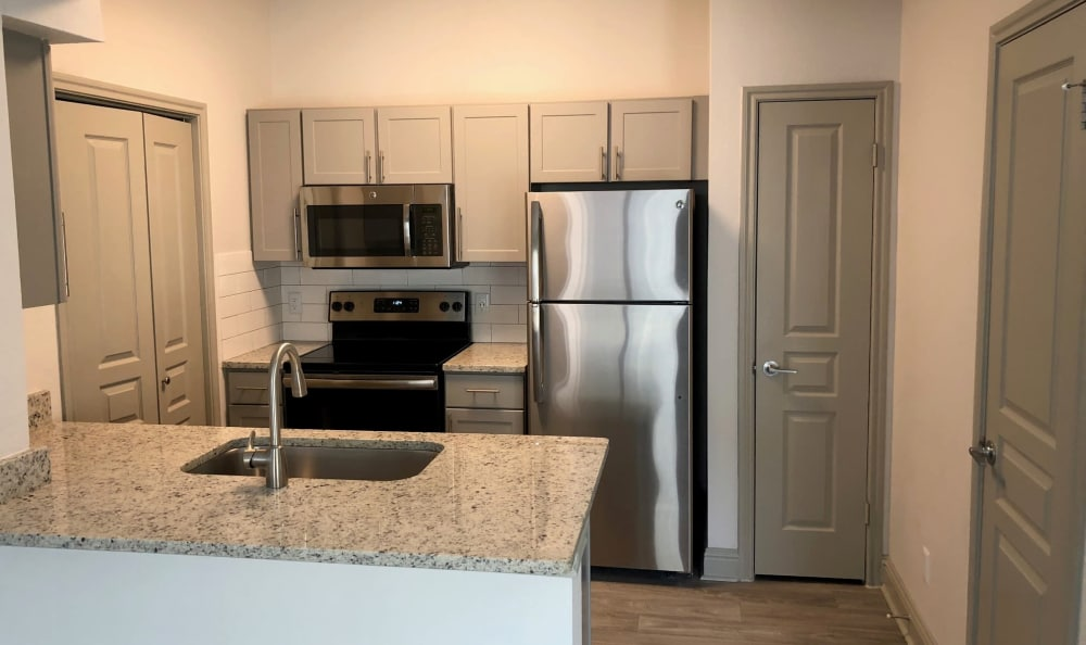 Modern kitchen at Abbey at Vista Ridge Apartments in Lewisville