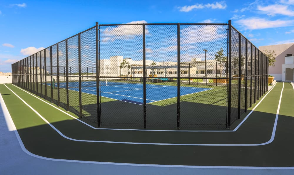 Running track around the tennis courts at Loftin Place Apartments in West Palm Beach, Florida