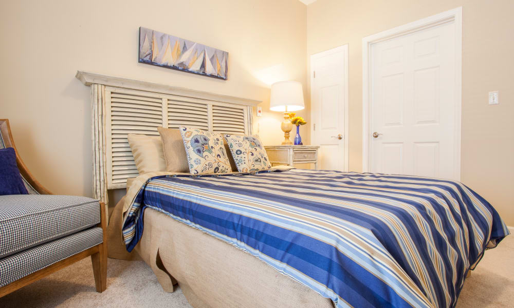 An apartment bedroom and closet at Keystone Place at  Buzzards Bay in Buzzards Bay, Massachusetts