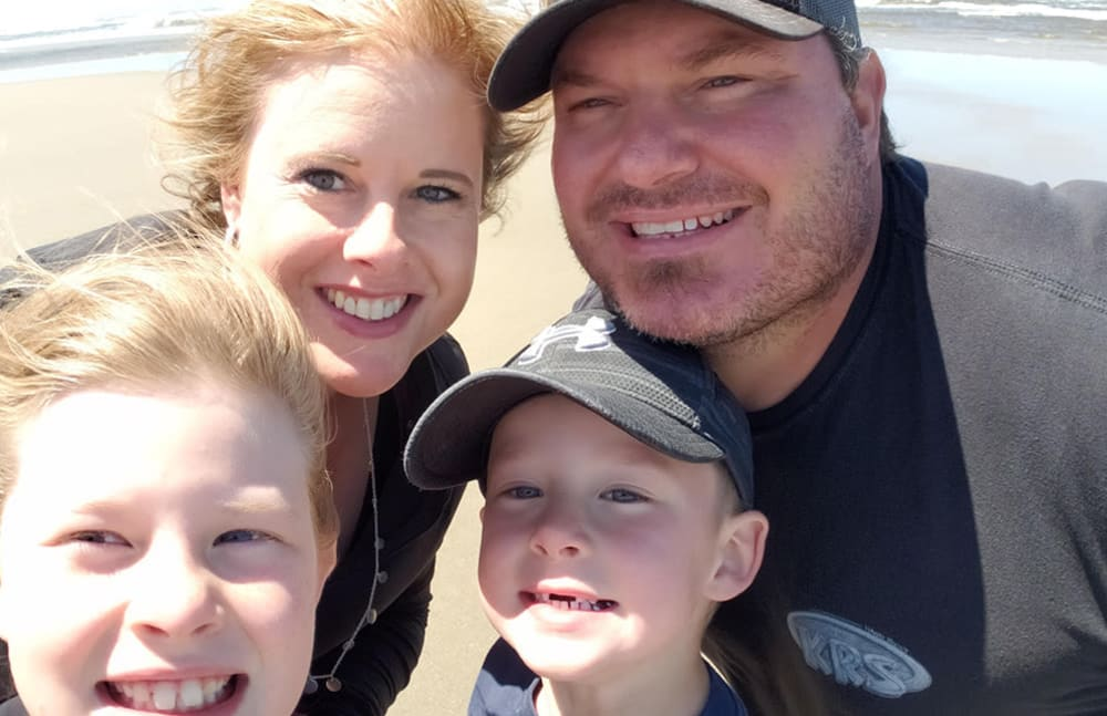 Christy from Touchmark at Meadow Lake Village in Meridian, Idaho and her family on the beach.