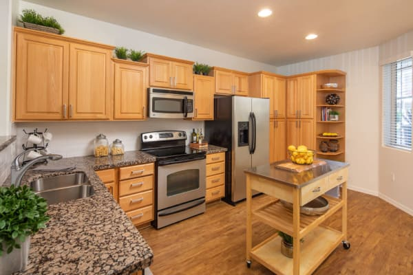 Kitchen with wooden cabinets at The Fleetwood in Tempe, Arizona