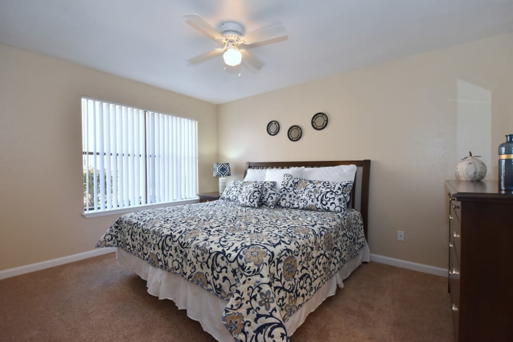 Bedroom with natural light at Green Meadows Apartments