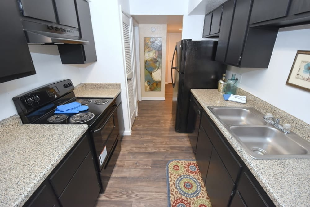 Kitchen with hardwood floors at Green Meadows Apartments