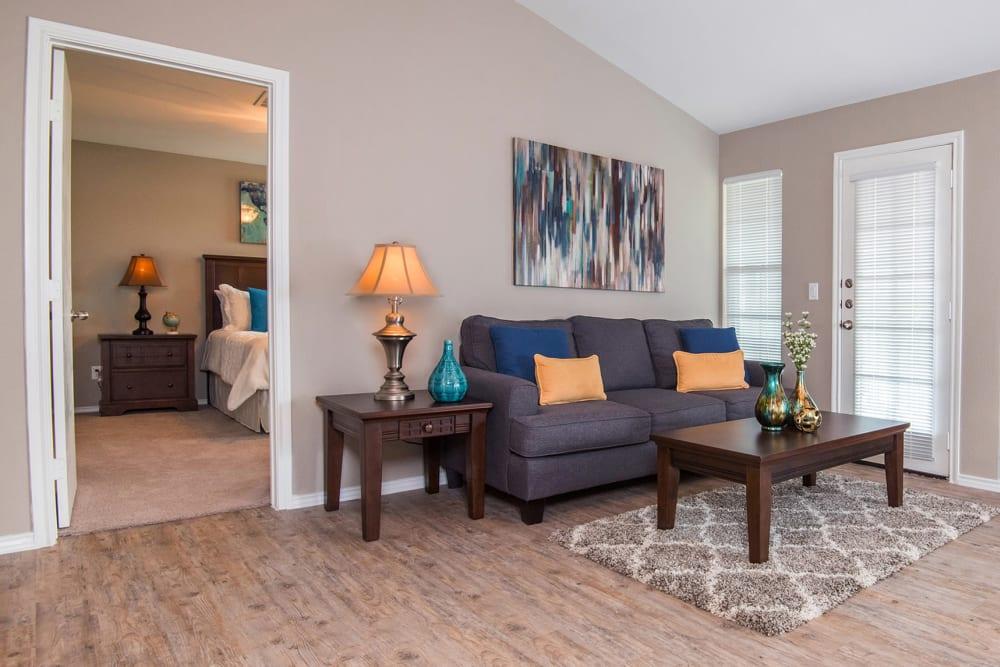 Living Room & Attached Bedroom at Carrollton Park of North Dallas in Dallas, Texas